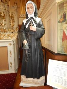 Statue of Marie Bourgeoys, Eglise de la Sainte-Famille, Isle d'Orleans, Quebec.